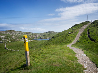 Footpath in ireland on the way to sheeps head lighthouse