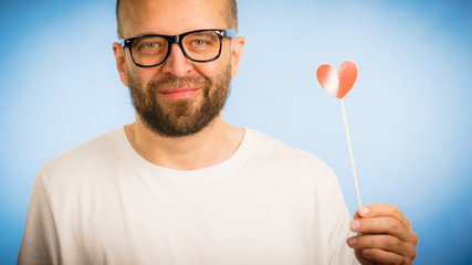 Adult man with heart on stick