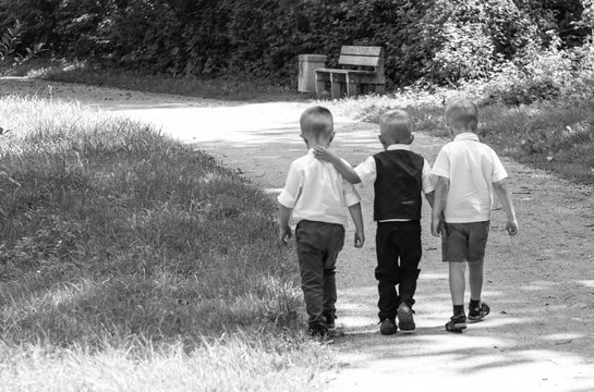 Children go together on the path In Park