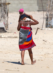 African woman carrying a child