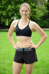 Sporty woman doing sports, running and jogging outdoors in the is park taking a break