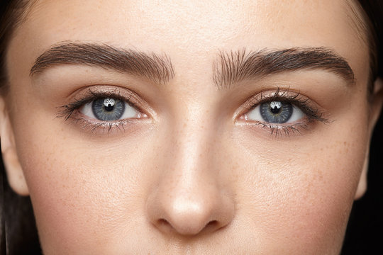 girl with nude make-up with blue eyes closeup