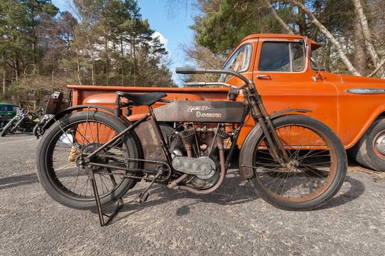 Vintage Harley Davidson motorcycle (circa 1920) and Chevy truck in Farnborough - March 29, 2013