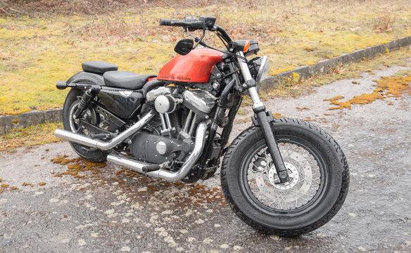 rain soaked Harley Davidson motorcycle in Rushmoor, UK - April 3, 2015