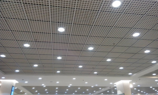 Grid ceiling and gypsum ceiling make an nice architectural interior false ceiling view or design for an commercial building such as shopping mall and office building