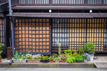 Flowers and decorative plants in front of the traditional Japanese house in Takayama Japan