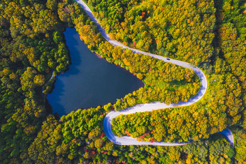 Aerial view of winding road on mountain in Autumn