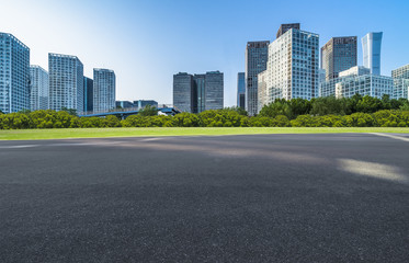Fotomurales - Asphalt road and modern city commercial buildings in Beijing, China