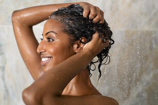 Woman bathing and washing hair