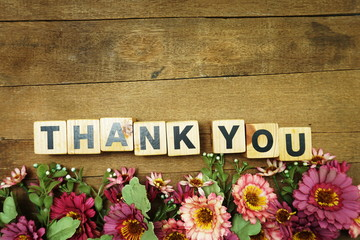 Thank You alphabet letters on wooden background