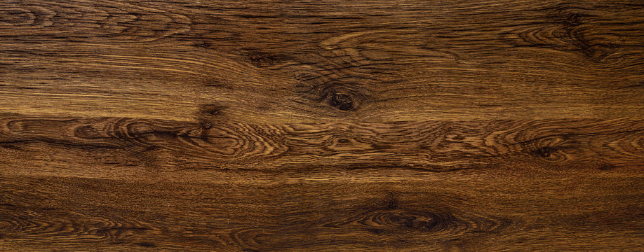 Polished wood surface. The background of polished wood texture.