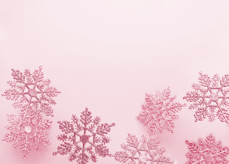 Festive winter background with decorative snowflakes in flying. Christmas, Winter or New Year concept with snowflakes. Flat lay