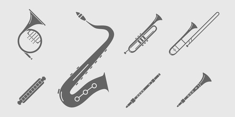 Music instruments Icons set - Vector solid silhouettes of wind instruments, saxophone, sax, tube, mouth organ and flute for the site or interface