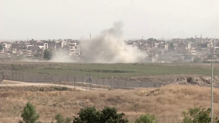 Smoke billows out after Turkish shelling on the Syrian border towns of Qamishli and Ras Al Ain
