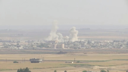 Smoke billows out after Turkish shelling on the Syrian border town of Ras Al Ain