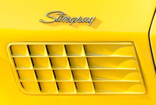 Vehicle badge closeup of an American Corvette Stingray muscle car in Rushmoor, UK - March 25, 2016