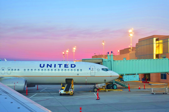 ALBUQUERQUE, NEW MEXICO -3 NOV 2018- View of an airplane from United Airlines (UA) on a pink sky at sunset at the Albuquerque International Sunport (ABQ) serving Albuquerque and Santa Fe, NM.