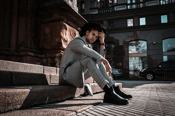 Urban man portrait in casual clothes with stylish hairstyle on city street. Handsome young fashion guy. Beautiful trendy model