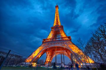 closeup of illuminated Eiffel Tower at night, Paris