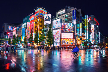 Neon lights and billboard advertisements on buildings at Akihabara at rainy night, Tokyo, Japan