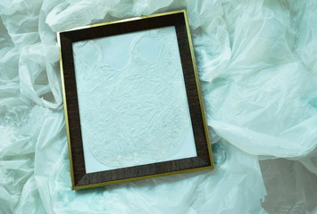 wooden picture frame on white plastic bag packing stacking