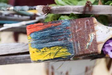 Brush with paints as decoration for an art shop