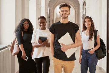 Multiracial group of students smiling and looking at camera