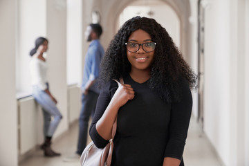Portrait of african female college student smiling at camera