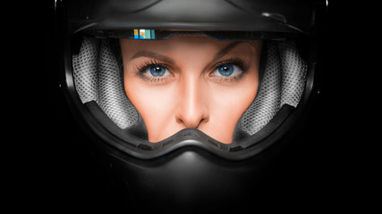 Close up view of a woman face in biker helmet.