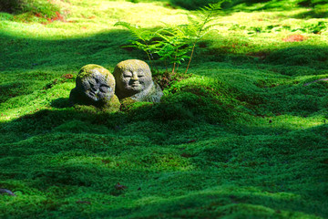The moss garden and stone statues in the Sanzenin temple, Ohara, Kyoto, Japan