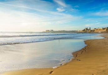 Footprints in the sand on Santa Maria del Mar beach in Cadiz, Spain, Andalusia