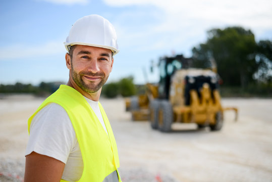 portrait of handsome foreman construction worker on a industrial building industry construction site