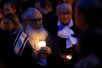 People gather at the synagogue in Halle