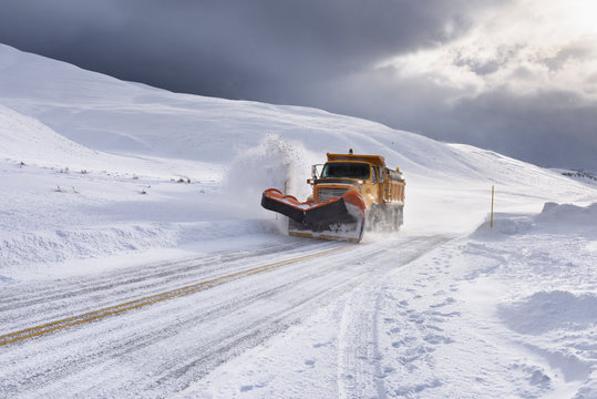 Yellow Snow Plow Clearing Snow in Wyoming