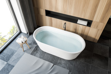 Top view of gray tile floor bathroom with tub