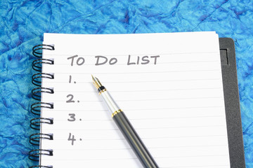 To Do List written on a book with pen
