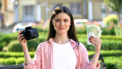 Female showing camera and bunch of euros at camera, profitable profession