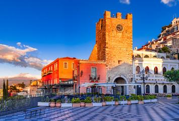 Taormina, Sicily, Italy: Panoramic view of the morning square Piazza IX Aprile with the Clock Tower...