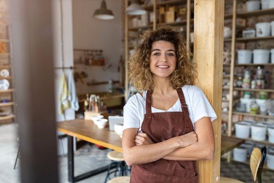 Portrait of woman pottery artist in art studio
