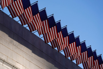 U.S. flags fly atop Los Angeles City Hall in downtown Los Angeles