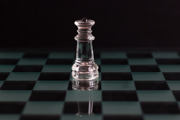 Queen chess piece on a black background