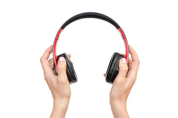 Woman's hands holding headphones. Isolated on white.