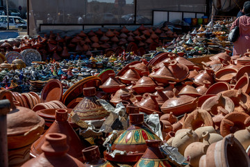 Dozens of tagine clay pots for sale in outdoor souk in Morocco