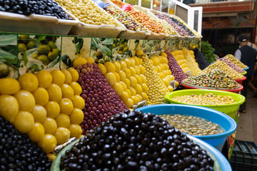 Colorful olives and lemons on beautiful display in Morocco market