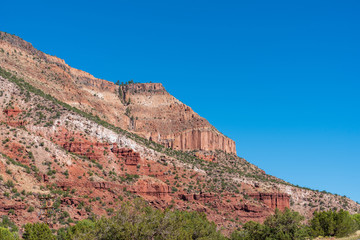 Low angle landscape of multi-colored stone mountain in Jemez National Recreation Area in New Mexico