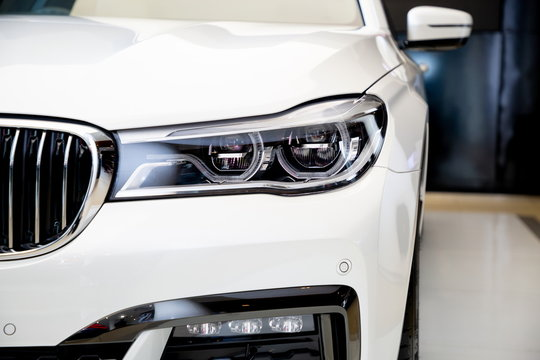 Bangkok , Thailand 2019 : close up headlight front view of BMW 730 Ld M Sport luxury car presented in motor show Thailand .