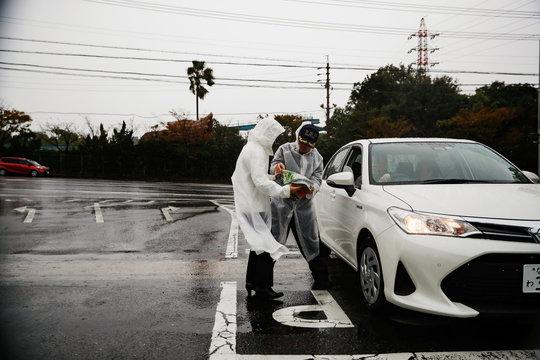 Officials check a map at Suzuka Circuit in Suzuka