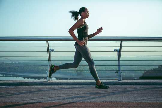Keeping fit while running outdoors stock photo