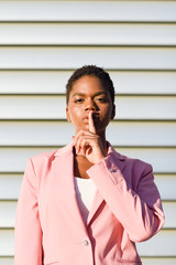 African American business woman doing silence gesture.