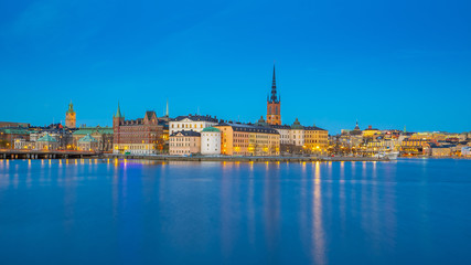 Wall Mural - Stockholm city skyline with view of Gamla Stan at night in Stockholm, Sweden